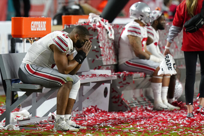 Ohio State players sit on the bench after their loss to Alabama in an NCAA College Football Playoff national championship game, Monday, Jan. 11, 2021, in Miami Gardens, Fla. Alabama won 52-24. (AP Photo/Lynne Sladky)