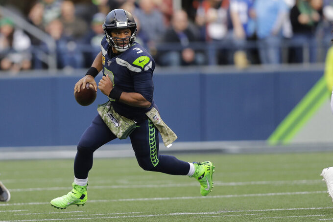 49ers prepare for tough test of facing Russell Wilson