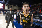 Winthrop guard Chandler Vaudrin (52) celebrates following his team's upset victory over Saint Mary's in an NCAA men's college basketball game, Monday, Nov. 11, 2019 in Moraga, Calif. Winthrop defeated 18th-ranked Saint Mary's 61-59. (AP Photo/D. Ross Cameron)