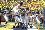 Army running back Sandon McCoy (3) celebrates his one-yard touchdown run in the first half of an NCAA college football game against Michigan in Ann Arbor, Mich., Saturday, Sept. 7, 2019. (AP Photo/Paul Sancya)