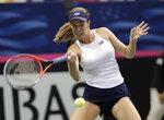 United States' Danielle Collins returns a shot from Australia's Daria Gavrilova during their first-round Fed Cup tennis match in Asheville, N.C., Sunday, Feb. 10, 2019. (AP Photo/Chuck Burton)2