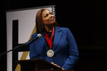 Music artist and actress Queen Latifah reacts after receiving the W.E.B. Dubois Medal for her contributions to black history and culture during ceremonies at Harvard University, Tuesday, Oct. 22, 2019, in Cambridge, Mass. (AP Photo/Elise Amendola)
