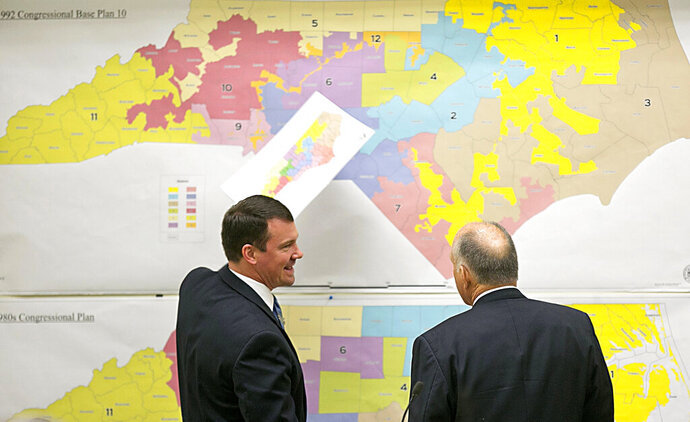 FILE - In this Tuesday, Feb. 16, 2016 file photo, Republican state Sens. Dan Soucek, left, and Brent Jackson, right, review historical maps during The Senate Redistricting Committee for the 2016 Extra Session in the Legislative Office Building at the N.C. General Assembly, in Raleigh, N.C.  North Carolina's congressional map is being challenged again on accusations that Republican lawmakers fashioned districts to maximize GOP seats. Democratic and independent voters sued on Friday, Sept. 27, 2019 in state court, alleging extreme partisanship in how the 13 districts were drawn.  (Corey Lowenstein/The News & Observer, File via AP, File)
