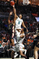 Miami guard Harlond Beverly (5) rebounds the ball against Florida State guard Anthony Polite (2) during the first half of an NCAA college basketball game on Saturday, Jan. 18, 2020, in Coral Gables, Fla. (AP Photo/Brynn Anderson)