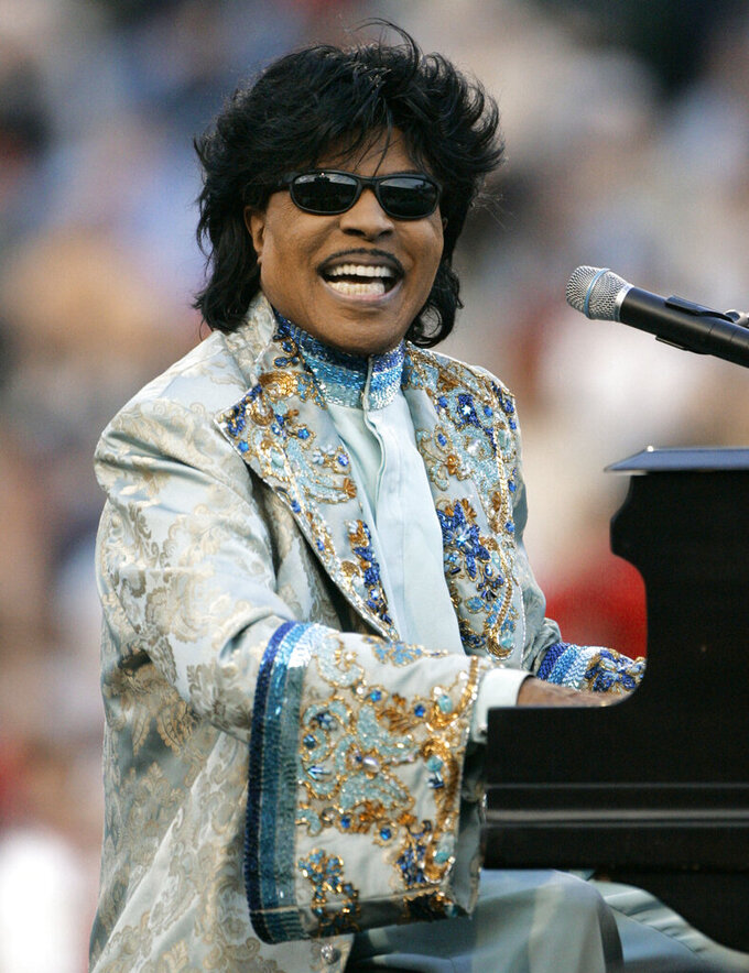 "FILE - Little Richard performs during halftime at the Liberty Bowl in Memphis, Tenn. on Dec. 31, 2004. ESPN is changing their ""Monday Night Football"" theme song. The season will feature a new version of Little Richard's hit ""Rip It Up,"" featuring new instrumentals and backup vocals from the Virginia-based band Butcher Brown. Hank Williams Jr. had sung the theme song for years in a version of his hit ""All My Rowdy Friends Are Coming Over Tonight."" (AP Photo/Mark Humphrey, File)"