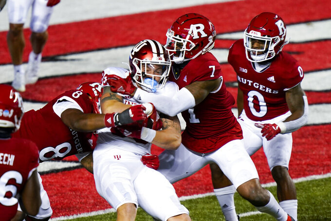 Rutgers linebacker Tyshon Fogg (8) and defensive back Brendon White (7) bring down Indiana tight end Peyton Hendershot in the third quarter of an NCAA college football game, Saturday, Oct. 31, 2020, in Piscataway, N.J. (AP Photo/Corey Sipkin)