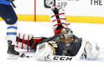 Vegas Golden Knights goaltender Marc-Andre Fleury makes a save against the Winnipeg Jets during the third period of Game 3 of the NHL hockey playoffs Western Conference finals, Wednesday, May 16, 2018, in Las Vegas. (AP Photo/John Locher)