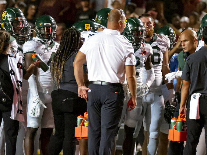 Baylor coach Dave Aranda, right, talks with the team during the second half of an NCAA college football game against Texas State on Saturday, Sept. 4, 2021, in San Marcos, Texas. Baylor won 29-20. (AP Photo/Michael Thomas)