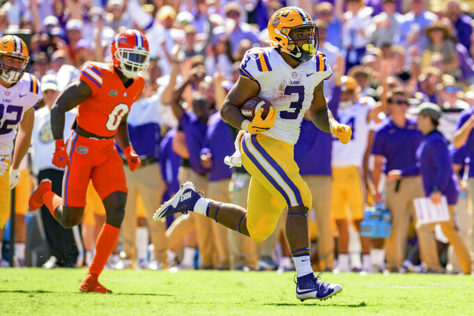 LSU running back Tyrion Davis-Price (3) scores a touchdown against Florida in the second half of an NCAA college football game in Baton Rouge, La., Saturday, Oct. 16, 2021. (AP Photo/Matthew Hinton)