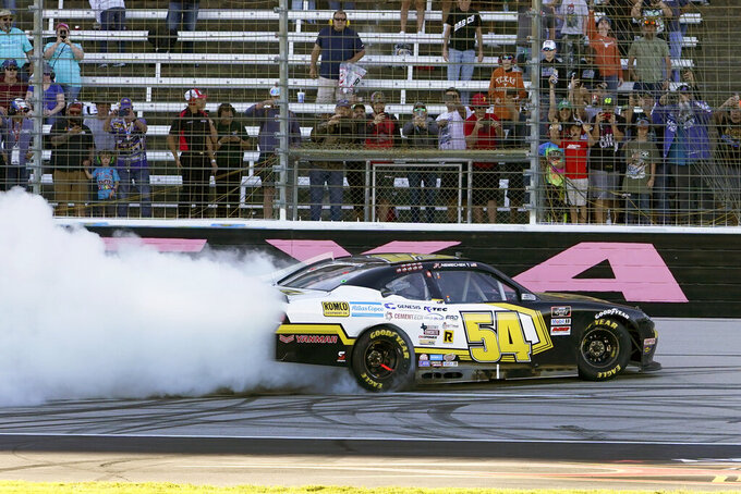 John H. Nemechek (54) celebrates after winning a NASCAR Xfinity Series auto race at Texas Motor Speedway Saturday, Oct. 16, 2021, in Fort Worth, Texas. (AP Photo/Larry Papke)