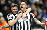 Newcastle United's Joselu, right, celebrates scoring his side's first goal of the game with team mate Paul Dummett during the English Premier League soccer match against Swansea City at St James' Park, Newcastle, England, Saturday Jan. 13, 2018. (Owen Humphreys/PA via AP)