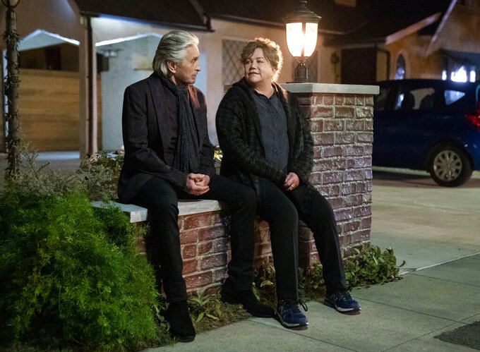"""This image released by Netflix shows Michael Douglas, left, and Kathleen Turner in a scene from the third and final season of """"The Kominsky Method."""" (Erik Voake/Netflix via AP)"""