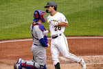 Pittsburgh Pirates' Adam Frazier (26) heads to the dugout past Chicago Cubs catcher Victor Caratini after hitting a solo home run off starting pitcher Alec Mills during the third inning of a baseball game in Pittsburgh, Thursday, Sept. 24, 2020. The Pirates won 7-0.(AP Photo/Gene J. Puskar)