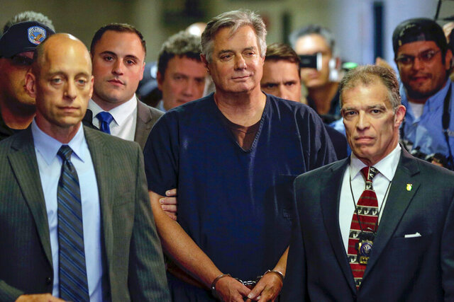 FILE - In this June 27, 2019 file photo, Paul Manafort, center, arrives at court in New York. In paperwork made public on Thursday, July 2, 2020. New York appellate judges on Thursday, Oct. 22, 2020, have upheld a lower judge's decision to dismiss state mortgage fraud charges against Paul Manafort on double jeopardy grounds. (AP Photo/Seth Wenig, File)