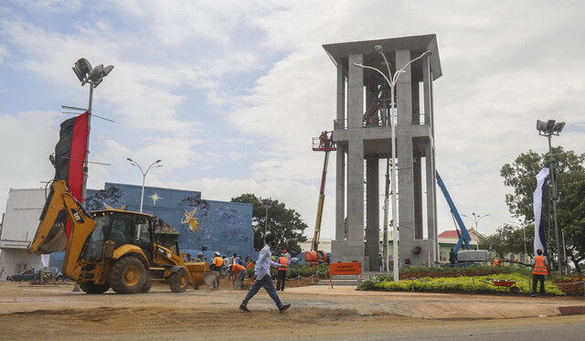 Workers ready a new monument, called the Peace Bell, before its inauguration ceremony later in the day in Managua, Nicaragua, Friday, July 17, 2020. Nicaraguan President Daniel Ortega's government is being deterred by the new coronavirus from holding the usual mass celebration to mark the victory of the country's revolution July 19, so will instead unveil a new addition to its collection of monuments. (AP Photo/Alfredo Zuniga)