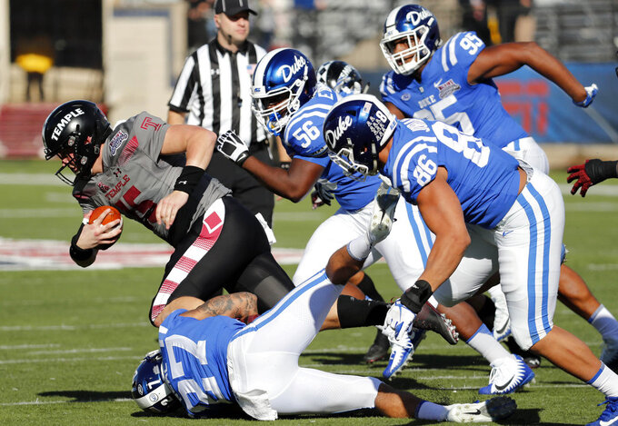 Temple quarterback Anthony Russo (15) is sacked by Duke safety Damani Neal (27) as others pursue in the second half of the Independence Bowl NCAA college football game in Shreveport, La., Thursday, Dec. 27, 2018. (AP Photo/Rogelio V. Solis)
