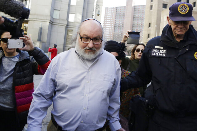 "Convicted spy Jonathan Pollard leaves a federal courthouse in New York Friday, Nov. 20, 2015. Israeli Prime Minister Benjamin Netanyahu has phoned Pollard, the former U.S. Navy analyst convicted of spying for Israel in the 1980s. In call Tuesday, Nov. 24, 2020 Netanyahu told Pollard that ""we're waiting for you."" The U.S. Justice Department announced last Friday that Pollard had completed his parole, clearing the way for him to move to Israel 35 years after he was arrested. (AP Photo/Mark Lennihan)"