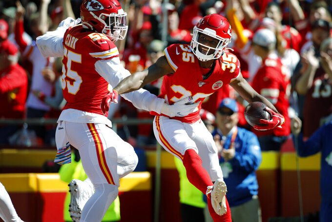 Kansas City Chiefs cornerback Charvarius Ward (35) celebrates with defensive end Frank Clark (55) on a fumble by Houston Texans wide receiver DeAndre Hopkins during the first half of an NFL football game in Kansas City, Mo., Sunday, Oct. 13, 2019. (AP Photo/Colin E. Braley)