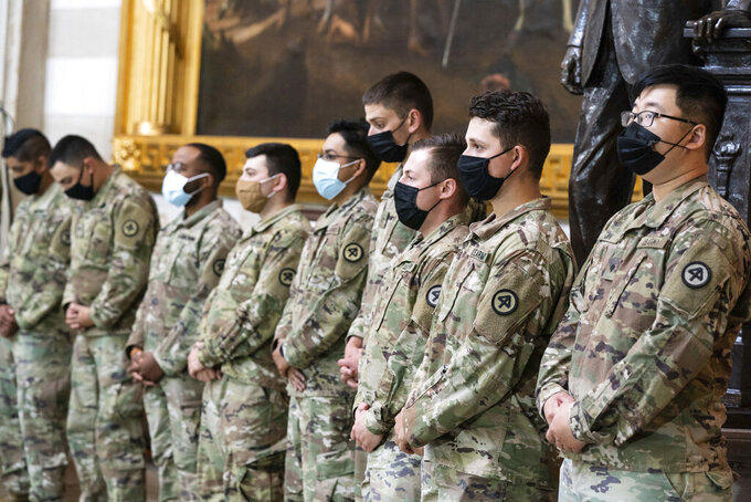 "National Guard troops pay respects to U.S. Capitol Police officer William ""Billy"" Evans, as Evans lies in honor in the Rotunda at the U.S. Capitol, Tuesday, April 13, 2021 in Washington.(Anna Moneymaker/The New York Times via AP, Pool)"