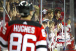 New Jersey Devils fans watch center Jack Hughes (86) warm up before the start of an NHL hockey game against the Florida Panthers, Monday, Oct. 14, 2019, in Newark, N.J. (AP Photo/Mary Altaffer)