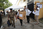 Sri Lankan polling officers carry election material as they dispatch them to polling centers ahead of the parliamentary elections in Colombo, Sri Lanka, Tuesday, Aug. 4, 2020. Sri Lankans are voting in parliamentary elections Wednesday that are expected to strengthen President Gotabaya Rajapaksa's grip on power. Parts of the party are also calling for a two-thirds majority in Parliament so it can amend the constitution to restore presidential powers curbed by a 2015 constitutional change. (AP Photo/Eranga Jayawardena)