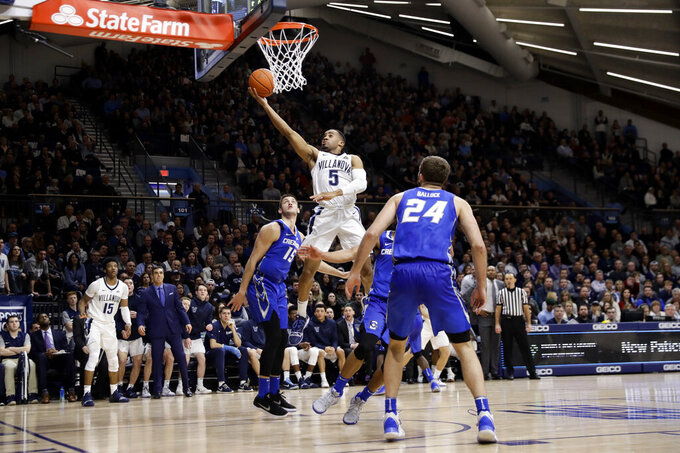 Villanova's Phil Booth (5) goes up for a shot as Creighton's Martin Krampelj (15) and Mitch Ballock (24) watch during the second half of an NCAA college basketball game Wednesday, Feb. 6, 2019, in Villanova, Pa. Villanova won 66-59 in overtime. (AP Photo/Matt Slocum)