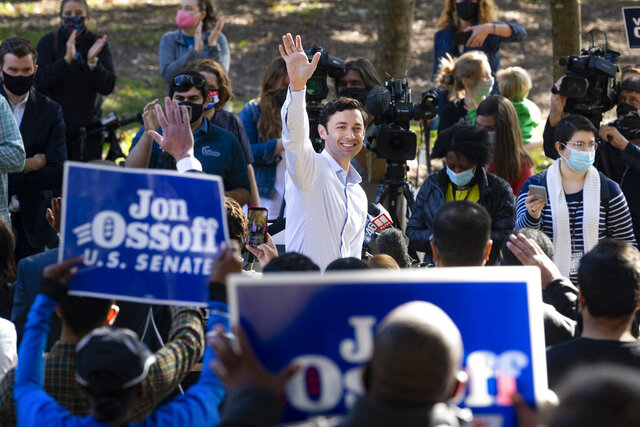 Georgia Democratic candidate for U.S. Senate Jon Ossoff rallies supporters for a run-off against Republican candidate Sen. David Perdue, as they meet in Grant Park, Friday, Nov. 6, 2020, in Atlanta. (AP Photo/John Amis)