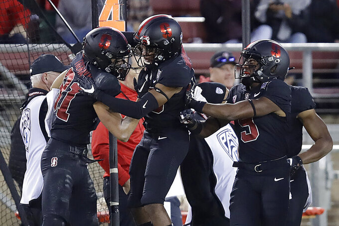 Stanford's Brycen Tremayne, left, celebrates after scoring a touchdown on a blocked UCLA punt during the first half of an NCAA college football game Thursday, Oct. 17, 2019, in Stanford, Calif. (AP Photo/Ben Margot)