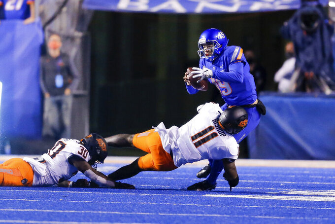Boise State quarterback Hank Bachmeier (19) is sacked by Oklahoma State linebacker Lamont Bishop (11) during the second half of an NCAA college football game Saturday, Sept. 18, 2021, in Boise, Idaho. (AP Photo/Steve Conner)