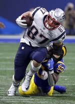 New England Patriots' Rob Gronkowski (87) is tackled by Los Angeles Rams' Samson Ebukam (50) after catching a pass during the second half of the NFL Super Bowl 53 football game Sunday, Feb. 3, 2019, in Atlanta. (AP Photo/David J. Phillip)