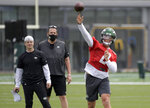 CORRECTS TO OFFENSIVE COORDINATOR MIKE LAFLEUR, LEFT, NOT QUARTERBACKS COACH ROB CALABRESE - New York Jets first-round draft pick Zach Wilson (2) works out as offensive coordinator Mike Lafleur, left, and passing game specialist Greg Knapp, center, look on during NFL football rookie camp, Friday, May 7, 2021, in Florham Park, N.J. (AP Photo/Bill Kostroun)