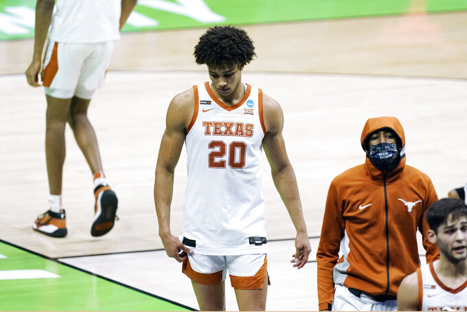 Texas' Jericho Sims (20) leaves the court after Texas lost to Abilene Christian in a college basketball game in the first round of the NCAA tournament at Lucas Oil Stadium in Indianapolis Sunday, March 21, 2021. Abilene Christian won 53-52. (AP Photo/Mark Humphrey)