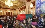 In this photo made available by Oman News Agency, people carry the coffin of Oman's Sultan Qaboos bin Said, at Sultan Qaboos Grand Mosque in Muscat, Oman, Saturday, Jan. 11, 2020. Sultan Qaboos bin Said, the Mideast's longest-ruling monarch who seized power in a 1970 palace coup and pulled his Arabian sultanate into modernity while carefully balancing diplomatic ties between adversaries Iran and the U.S., has died. He was 79. (Oman News Agency via AP)