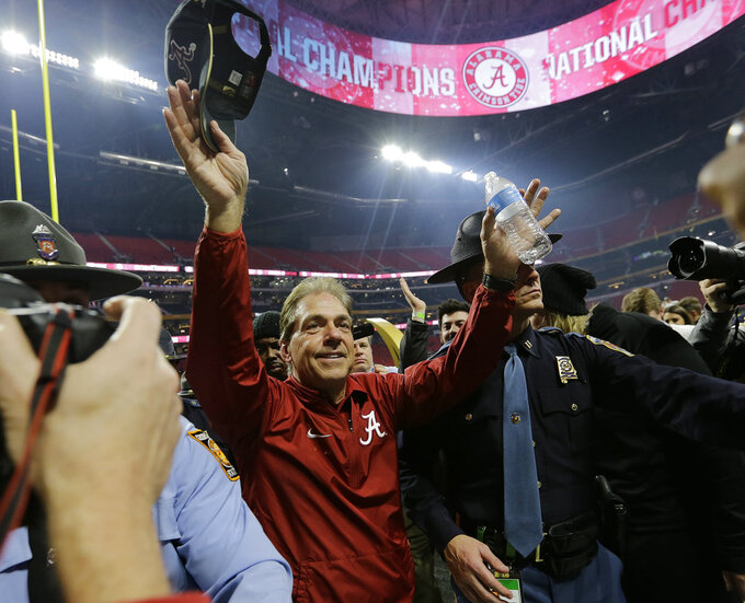 FILE - In this Jan. 8, 2018, file photo, Alabama head coach Nick Saban celebrates after overtime of the NCAA college football playoff championship game against Georgia, in Atlanta. Alabama already is the first team to win five AP titles in a span of less than 10 years. Winning a sixth against Clemson will left the Crimson Tide even further above other top college football dynasties and into the conversation for best runs in all of college sports. (AP Photo/David J. Phillip, File)