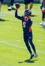 Denver Broncos quarterback Teddy Bridgewater (5) throws during  Denver Broncos OTAs at the team's headquarters Monday, May 24, 2021, in Englewood, Colo. (AP Photo/Jack Dempsey)