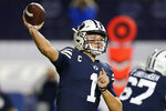 FILE - BYU quarterback Zach Wilson (1) throws down field in the first half during an NCAA college football game against Texas State in Provo, Utah, in this Saturday, Oct. 24, 2020, file photo. Wilson is a likely first round pick in the NFL Draft, April 29-May 1, 2021, in Cleveland. (AP Photo/Rick Bowmer, File)