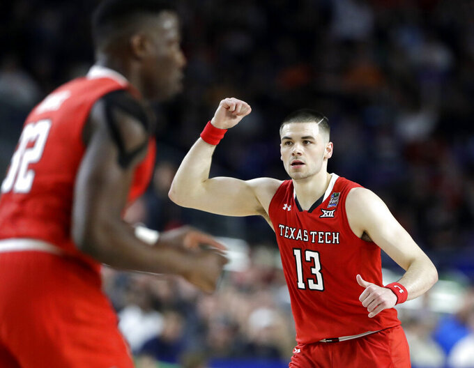 Texas Tech guard Matt Mooney celebrates after making a basket during the first half against Michigan State in the semifinals of the Final Four NCAA college basketball tournament, Saturday, April 6, 2019, in Minneapolis. (AP Photo/Jeff Roberson)