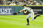 Pittsburgh Pirates' Kevin Newman is unable to catch a shallow fly ball from Chicago White Sox's Leury Garcia during the second inning of a baseball game Tuesday, Aug. 31, 2021, in Chicago. (AP Photo/Charles Rex Arbogast)