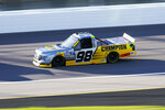 Grant Enfinger (98) drives during a NASCAR Truck Series auto race at Kansas Speedway in Kansas City, Kan., Friday, July 24, 2020. (AP Photo/Charlie Riedel)