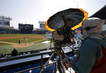 A TV cameraman films the LG Twins baseball team's intrasquad game in Seoul, South Korea, Sunday, April 5, 2020. The intrasquad game is aired live through the team's YouTube channel for its fans. The Korea Baseball Organization has postponed the start of new season to prevent the spread of the new coronavirus. (AP Photo/Lee Jin-man)
