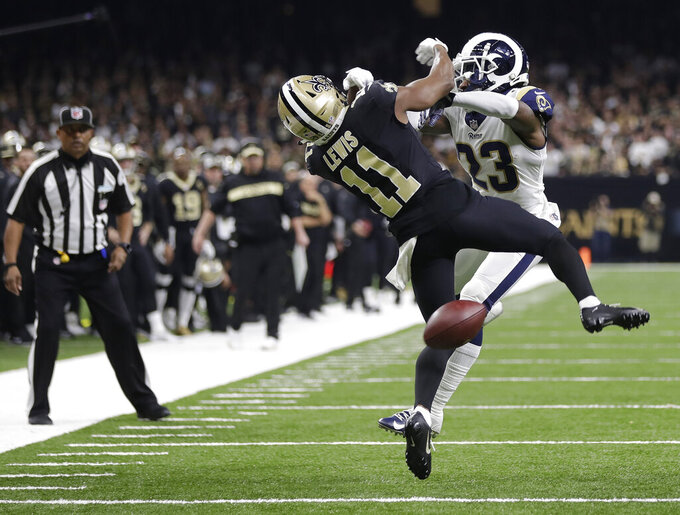 FILE - In this Jan. 20, 2019 file photo, Los Angeles Rams defensive back Nickell Robey-Coleman (23) breaks up a pass intended for New Orleans Saints wide receiver Tommylee Lewis (11) during the second half the NFL football NFC championship game in New Orleans.  (AP Photo/Gerald Herbert, File)