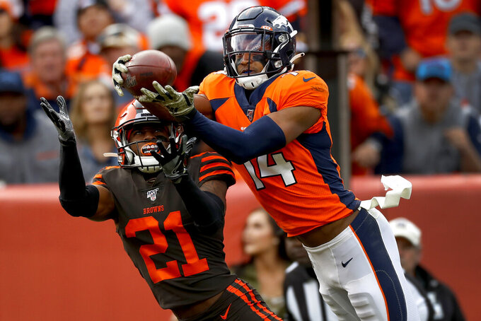 Denver Broncos wide receiver Courtland Sutton (14) pulls in a touchdown pass as Cleveland Browns cornerback Denzel Ward (21) defends during the first half of NFL football game, Sunday, Nov. 3, 2019, in Denver. (AP Photo/David Zalubowski)