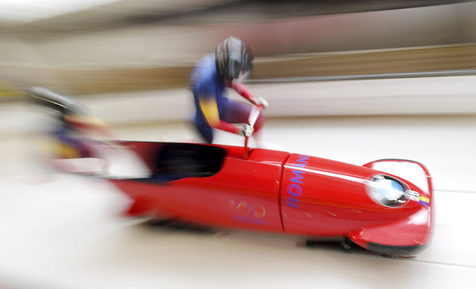 Andreea Grecu und Teodora Andreea Vlad from Rumania compete during the women's bobsled World Cup race in Schoenau am Koenigsee, Germany, Saturday, Jan. 12, 2019. (Tobias Hase/dpa via AP)