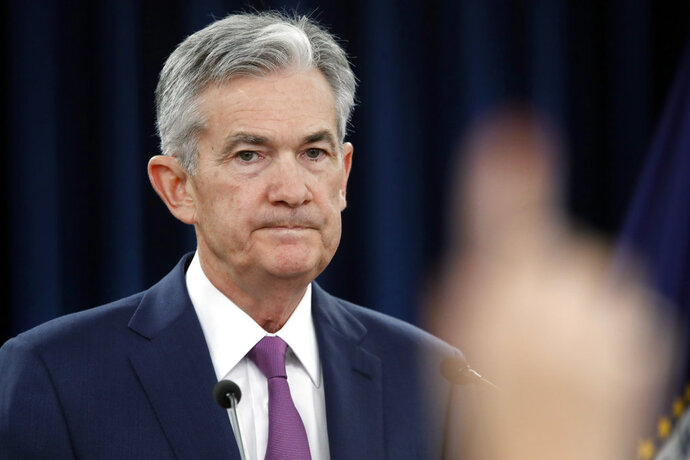 Federal Reserve Chair Jerome Powell speaks during a news conference after the Federal Open Market Committee meeting, Wednesday, June 13, 2018, in Washington. The Federal Reserve is raising its benchmark interest rate for the second time this year and signaling that it may step up its pace of rate increases because of solid economic growth and rising inflation. (AP Photo/Jacquelyn Martin)