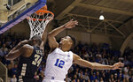Duke's Javin DeLaurier (12) defends against Wake Forest's Sunday Okeke (34) during the first half of an NCAA college basketball game in Durham, N.C., Tuesday, March 5, 2019. (AP Photo/Gerry Broome)