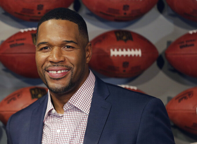 "FILE - In this Thursday, Nov. 30, 2017 file photo, Former New York Giant Michael Strahan poses for a picture at the opening of ""NFL Experience"" in Times Square, New York. Pro Football Hall of Famer and ""Good Morning America"" host Michael Strahan has tested positive for COVID-19 and is self-quarantining, according to people familiar with the situation. They spoke to The Associated Press on condition of anonymity Wednesday, Jan. 27, 2021 because of medical restriction issues. (AP Photo/Seth Wenig, File)"