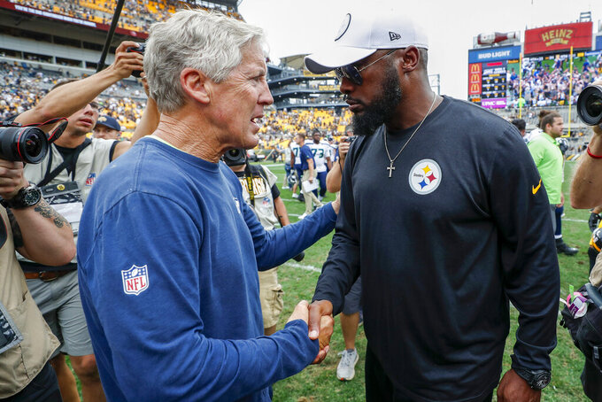 Seattle Seahawks head coach Pete Carroll, left, and Pittsburgh Steelers head coach Mike Tomlin shake hands on the field after an NFL football game, Sunday, Sept. 15, 2019, in Pittsburgh. The Seahawks defeated the Steelers 28-26. (AP Photo/Don Wright)