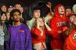 Clemson fans react at a viewing party during the NCAA College Football National Championship game between Clemson and LSU, Monday, Jan. 13, 2020, in Clemson, S.C. LSU won 42-25. (AP Photo/Richard Shiro)