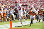 Oklahoma wide receiver CeeDee Lamb (2) scores on his third touchdown reception of the game in front of Texas defensive back D'Shawn Jamison (5) in the second half of an NCAA college football game at the Cotton Bowl, Saturday, Oct. 12, 2019, in Dallas. Lamb finished the game with 171 receiving yards as Oklahoma won 34-27. (AP Photo/Jeffrey McWhorter)