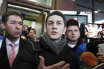 Moscow student Yegor Zhukov speaks to the media after his trial in Moscow, Russia, Friday, Dec. 6, 2019. The court on Friday gave student vlogger Zhukov a three-year suspended sentence and banned him from administering websites for two years on charges of inciting protests. He is among several dozen people who faced charges for their role in the past summer's protests in Moscow. (AP Photo)